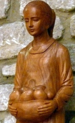 detail of a statue of Saint Emerentiana; date unknown, artist unknown; chapel of Saint-Emerentienne, Venasque, Vaucluse, Provence-Alpes-Côte d'Azur, France; photographed on 15 August 2014 by Peter Potrowl; swiped from Wikimedia Commons