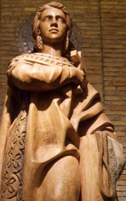 detail of a statue of Saint Encratia of Saragossa, date unknown, artist unknown; Crypt of the Church of Santa Engracia, Zaragoza, Spain; photographed on 4 October 2014 by Zarateman; swiped from Wikimedia Commons