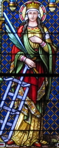 detail of a stained glass window of Saint Faith; Ott Brothers, 1892; church of Sainte-Foy, Sélestat, France; photographed on 2 July 2011 by Rh-67; swiped from Wikimedia Commons