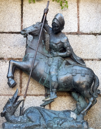 statue of Saint George and the Dragon; date and artist unknown; Church of Saint Francis Xavier, Convent of the Precious Blood, Caceres, Spain; photographed on 30 December 2012 by Pedro M Martínez Corada; swiped from Wikimedia Commons