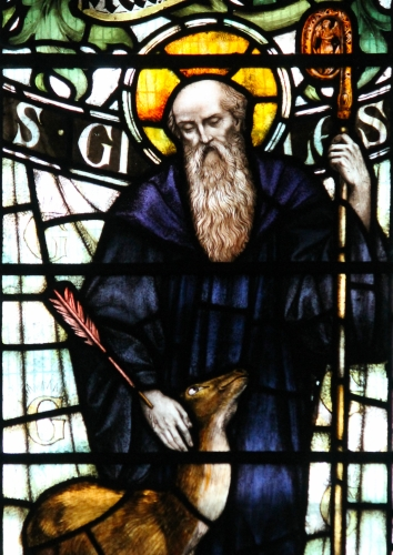 detail of a stained glass window of Saint Giles, date and artist unknown; Church of Saint Silyn, Wrecsam, Wales; photographed on 17 February 2017 by Llywelyn2000; swiped from Wikimedia Commons