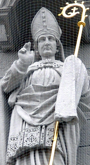 detail of a statue of Saint Kilian; 1890 by Josef Metzger; facade of Knights Chapel, Haßfurt, Lower Franconia, Germany; photographed on 30 August 2012 by Wolfgang Sauber; swiped from Wikimedia Commons