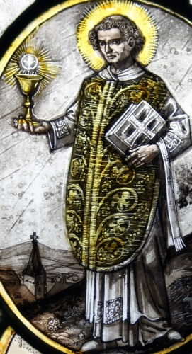 detail of a leaded glass window depicting Saint Lubentius, date and artist unknown; parish church of Saint Lubentius in Kell, Andernach, Germany; photographed on 3 August 2010 by GFreihalter; swiped from Wikimedia Commons