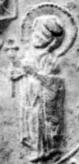Saint Marthe depicted at the foot of the pillar of her son