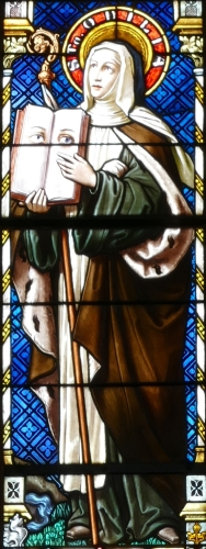detail of a stained glass window of Saint Odilia, by Burckhardt, 1899; Church of Saints Peter and Paul, Bas-Rhin Scherwiller, Alsace, France; photographed on 19 August 2015 by Ralph Hammann; swiped from Wikimedia Commons