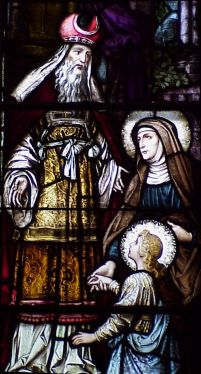 detail of a stained glass window of Saint Joachim with Saint Anne and the Blessed Virgin Mary; date and artist unknown; Cathedral of Saint Joseph, Macon Georgia; photographed in the summer of 2003 by the author