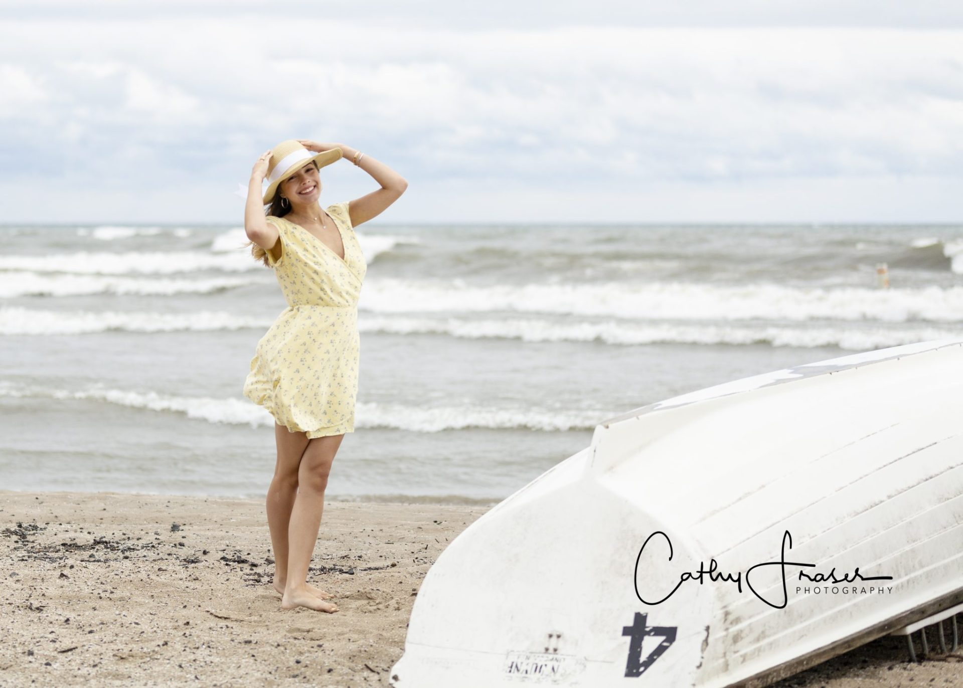 ellow dress, floppy hat, Rochester, New York, Charlotte Pier, Charlotte Beach, Great Lakes, life boat