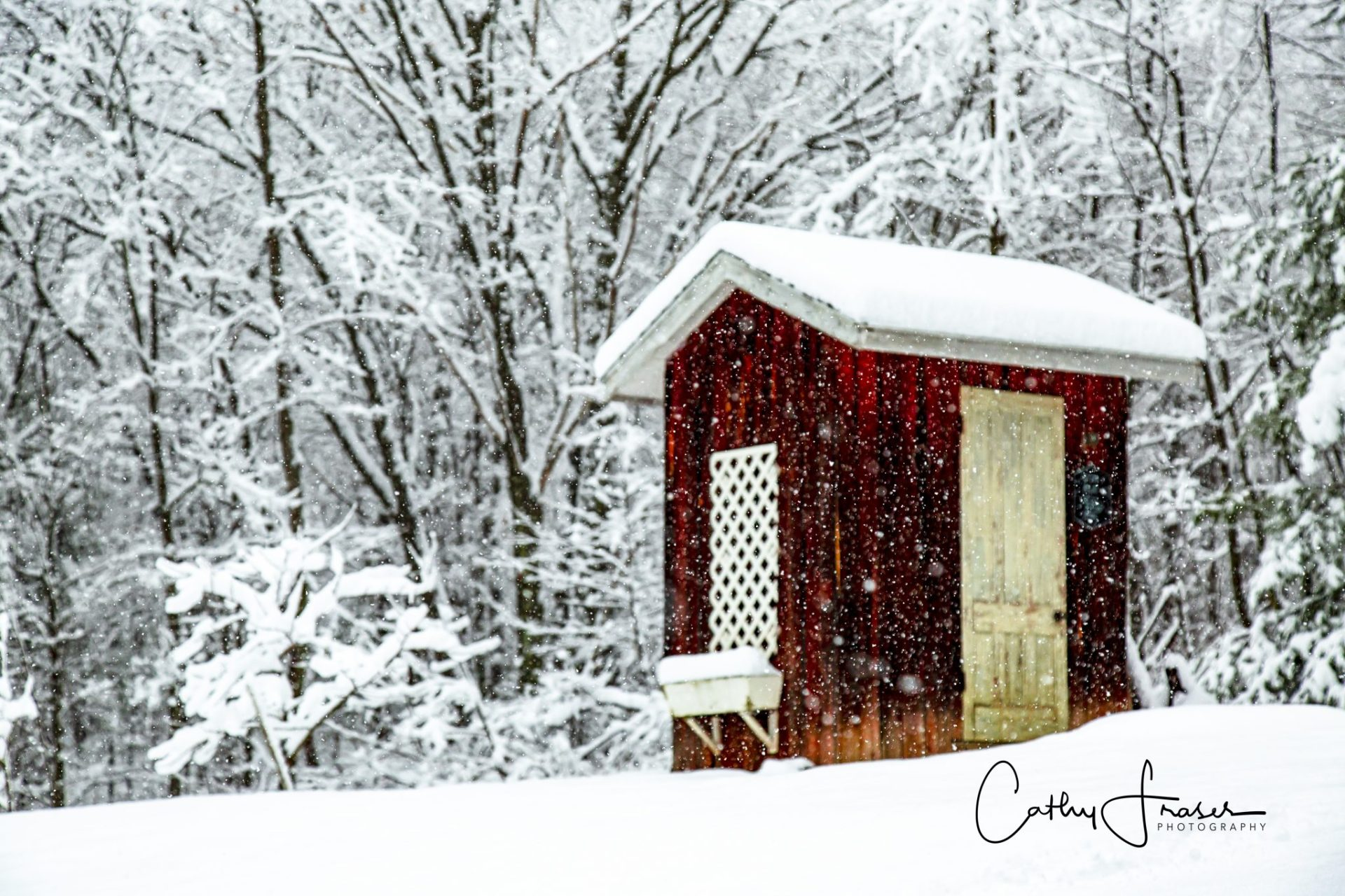 Landscape Photography of a small building on a hill in the middle of snowfall in New York