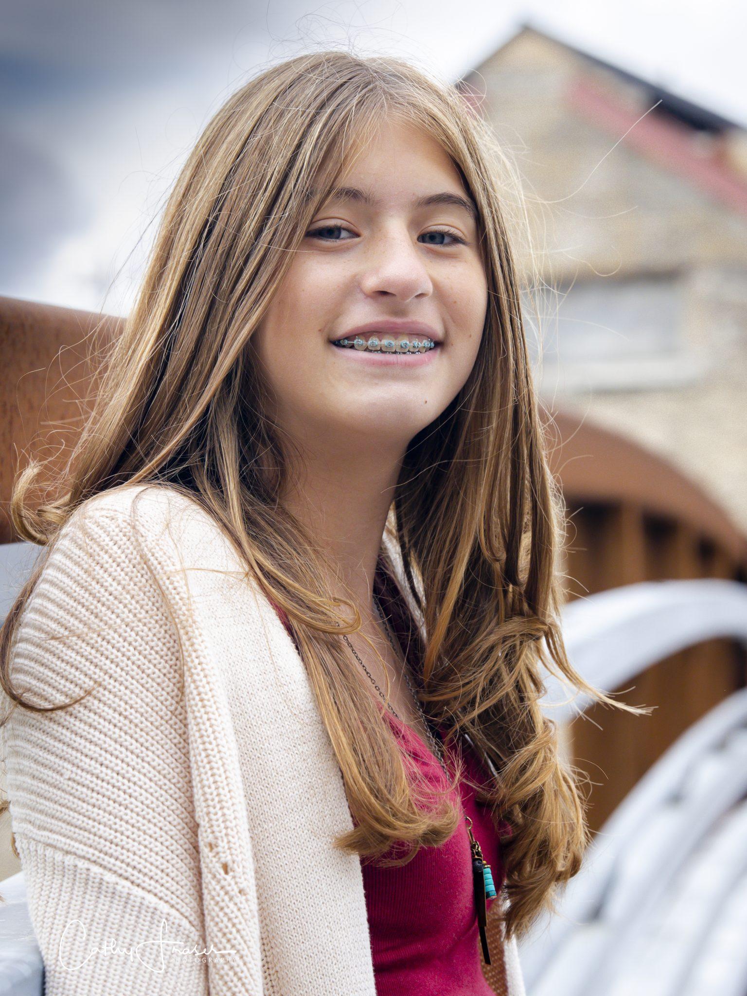 Teenage girl, professional headshot, Penn Yan, New York, standing on footbridge