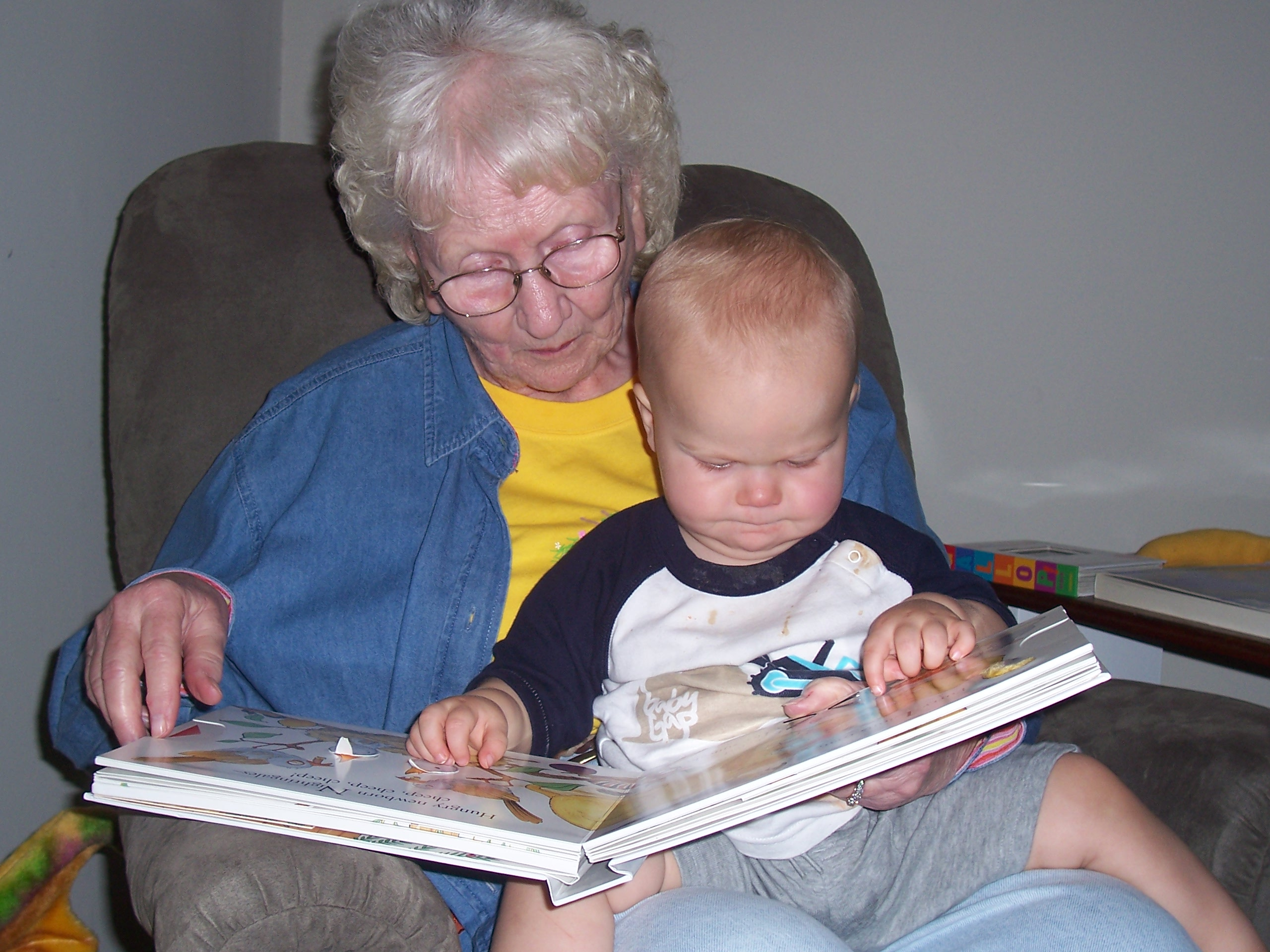 My mom reads to my grandson, Capt. Adorable. I love that they both are holding their mouths the exact same way.
