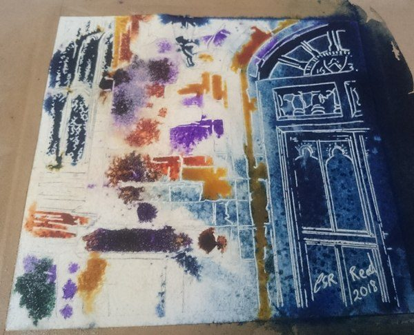 Painting in progress of buttress on Maids Moreton Church showing details of a leaded window and big wooden door