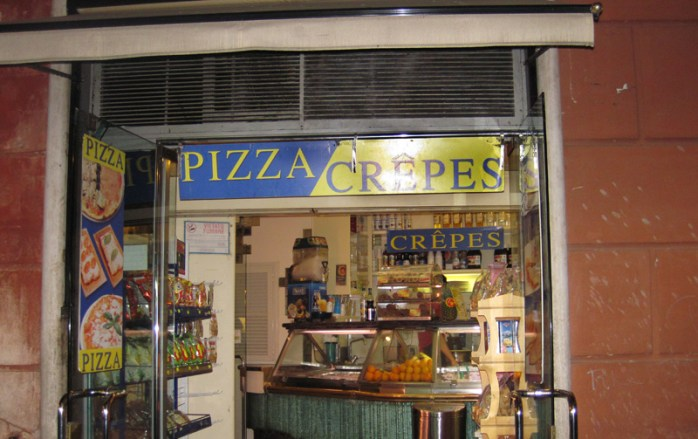 This place in Rome really went all out with two signs! Although, apparently this pizza guy they were expecting deserved three. Maybe I'll get three next year.