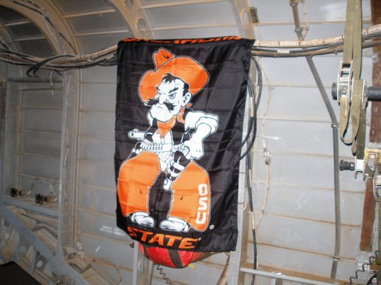 The OSU Flag aboard  a USMC CH-53 over Afghanistan