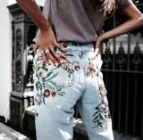 """This is probably my second favorite for this summer: the embroidered """"mom"""" jeans. Throw on any old top, some cute and comfy as hell jeans, and go do whatever the fuck you want to, because this outfit is hella universal and going to work for everybody, regardless of size, age, gender, color, you name it. Patches also work, but floral embroidery is my favorite."""