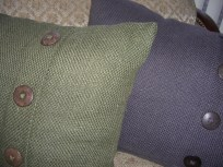 The pillows are rustic - almost straw-like - and have some interesting button-accents.