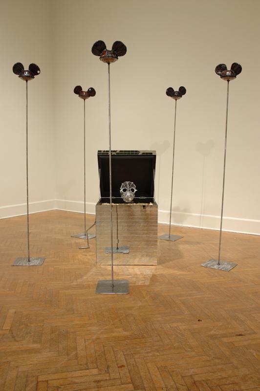 """Cracker Jack & The Ring of Awe"" 2′ x 2′ x 4′ (Box), 6′ x 11″ x11″ (Poles.) Installed at Corcoran Gallery of Art, Washington, DC"