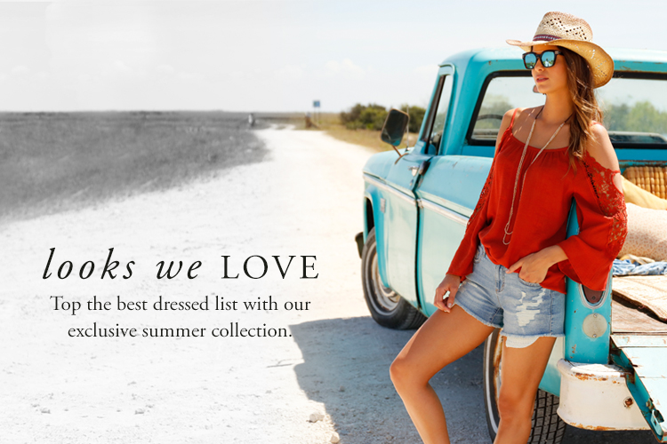 Looks we Love. Top the best dressed list with our exclusive summer collection. woman in a cold shoulder top, distressed denim shorts and a cowboy hat.