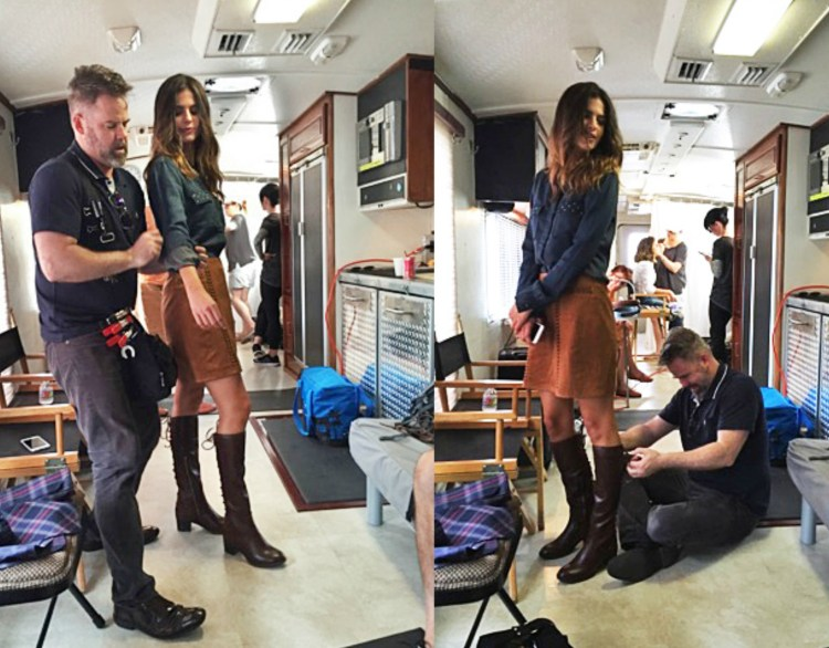 A behind the scenes shot of stylist preparing the models clothes.
