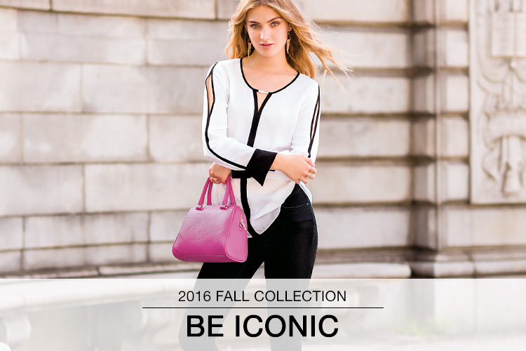 2016 Fall Collection: Be Iconic. A woman stands outside in a black and white top, black pants and a pink handbag.