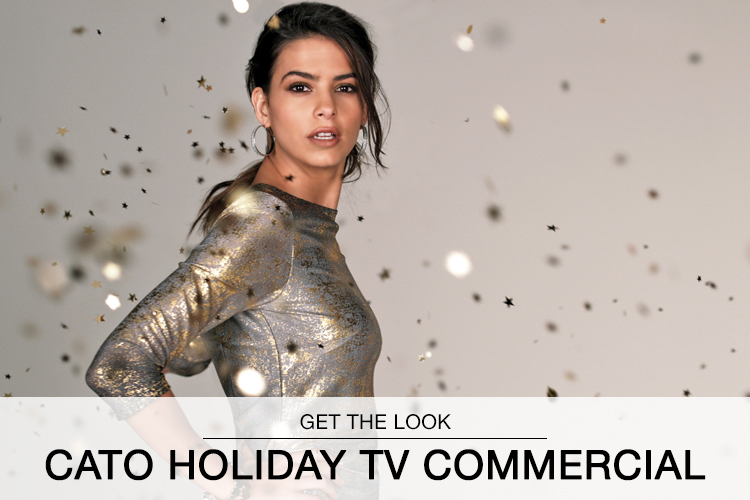 Get the Look: Cato Holiday TV Commercial. A still shot from the Cato holiday commercial of a model surrounded by gold confetti