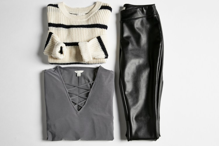 Double Duty Leggings. A lay down shot of faux leather leggings, a striped sweater and a blouse.