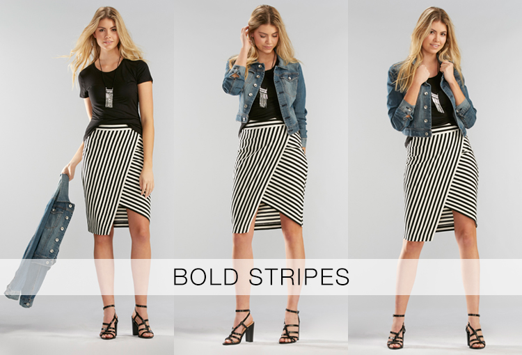 Bold Stripes. A beautiful young woman wearing a black t-shirt, denim jacket and a bold black and white stripe faux wrap skirt.