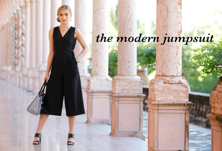 The Modern Jumpsuit. A beautiful young woman in a black cropped wide leg jumpsuit.