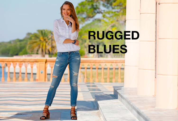 Rugged Blues. A beautiful woman outside wearing a white top and destructed jeans.