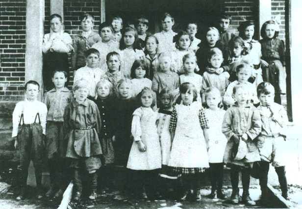 Leah Van Houtte, top row on right Amos Van Houtte, front row, second on left John Van Houtte, front row, second on left