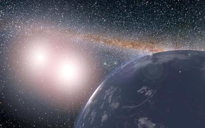 Interpretación artística de un planeta hipotético cubierto de agua alrededor del sistema estelar binario de Kepler-35A y B. Crédito: NASA JPL-Caltech.