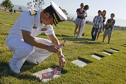 US_Navy_110530-N-HW977-025_Capt._Jay_Kadowaki_places_flags_at_the_grave_of_his_uncle,_U.S._Army_Spc._Robert_Kadowaki,_who_served_during_the_Vietnam