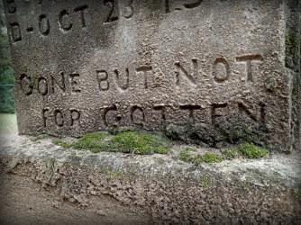 Gravestone that reads, GONE BUT NOT FORGOTTEN