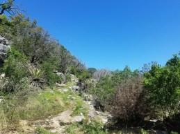 Exposed rocky Tinaja Trail with no shade.