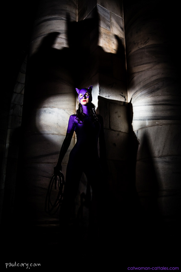Catwoman in the classicly perfect, iconic and purple Jim Balent costume in the shadow of Azrael Batman