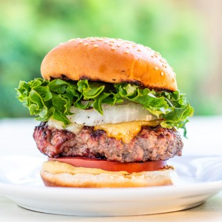 Bobby Flay put his spin on an otherwise traditional burger by adding grilled onions, horseradish mustard, and two cheeses - the double cheddar burger!