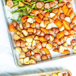 This recipe for one pan chicken sausage with roasted asparagus and potatoes is easy, healthy, kid-friendly, and can be prepared a bit ahead of time!