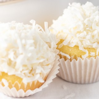 Light, fluffy, vanilla cake with cream cheese frosting makes up the base of this treat, but it's the shredded coconut that makes them snowball cupcakes!