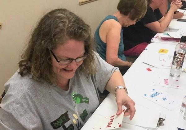 Woman making layered adhesive vinyl decal