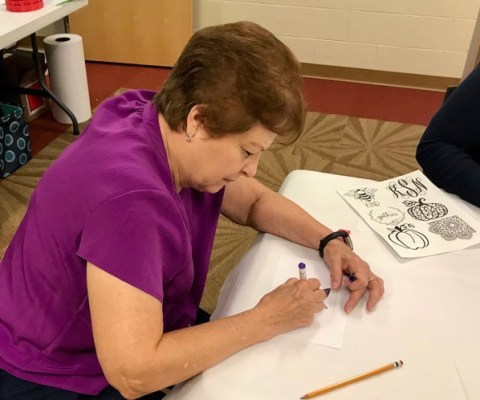 Photo of woman drawing with sublimation marker