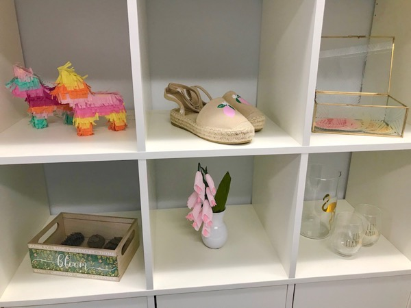 Silhouette craft projects displayed on an open shelving unit