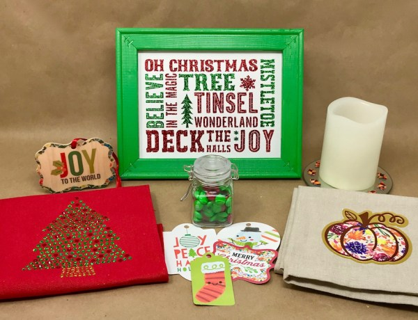 Group of holiday projects from holiday workshop including a pillow band, sublimated Christmas ornament, reverse canvas, print & cut Christmas tags, candle plate, and tea towel.