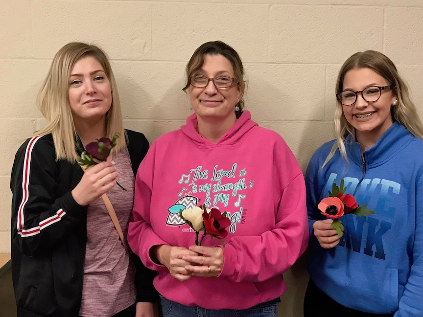 Mom and daughters with crepe paper flowers