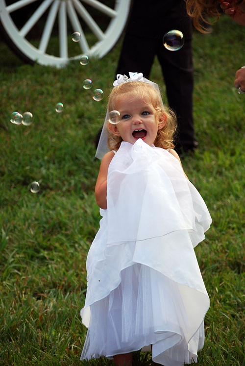 Happy flower girl at north georgia wedding venues