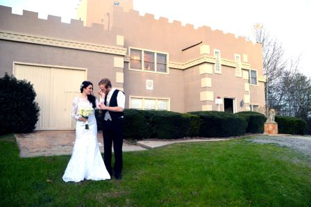 Young couple in front of a Cavender Castle one of the original North Georgia Wedding Venues
