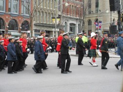 Remembrance Day - 2015, Ottawa, Canada. Hats of many shapes as a variety of Canadian Forces members parade past me