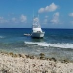 Boat runs aground on reef off Cayman Brac