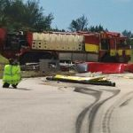 Brac fire officers flown to GCM after truck flips on runway