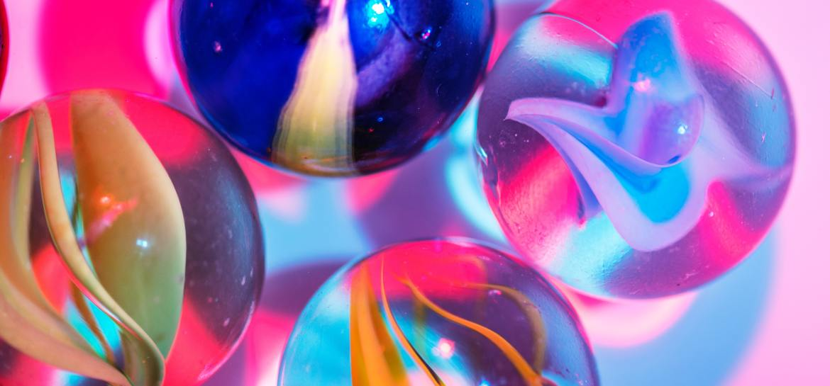 Marbles on pink background