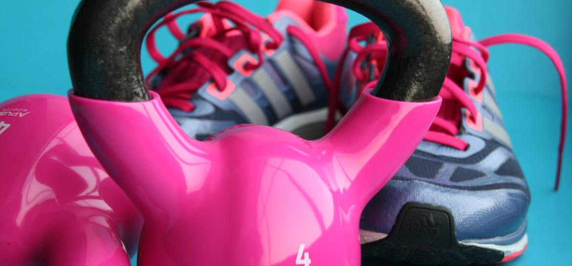 Pink kettle bell and trainers