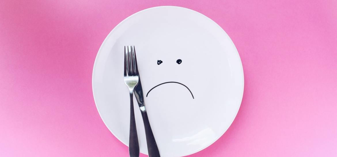 Plate, sad face, pink background